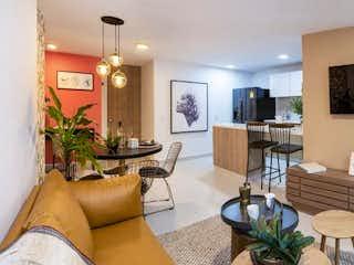 Una sala de estar llena de muebles y una televisión de pantalla plana en Apartamento En Venta En Medellin Los Colores