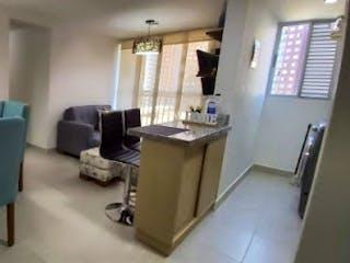 Una sala de estar llena de muebles y una ventana en Manzanillos