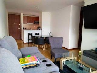 Una sala de estar llena de muebles y una chimenea en Apartamento en venta en El Trianón, 79mt con dos balcones