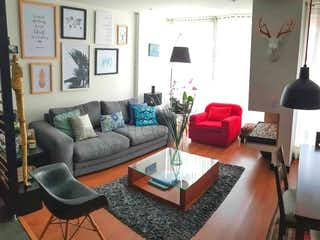 Una sala de estar llena de muebles y una televisión de pantalla plana en Apartamento duplex en venta en Santa Barbara de 99m2