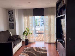 Una sala de estar llena de muebles y una chimenea en Apartamento en venta en Contador, de 58mtrs2