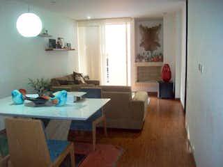 Una sala de estar llena de muebles y una ventana en Marizagua