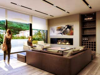 Una mujer sentada en un sofá en una sala de estar en Apartamento en venta en Santa Bárbara Oriental, de 110mtrs2