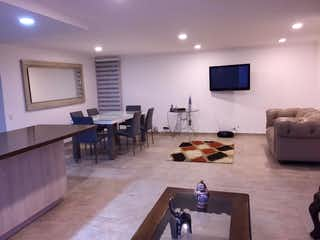 Una sala de estar llena de muebles y una televisión de pantalla plana en Apartamento en venta en El Campestre, 121mtrs2