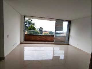 Una vista de una sala de estar desde una ventana en URB ORION