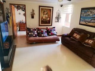 Una sala de estar llena de muebles y una pintura en Apartamento en venta en Los Almendros, de 198mtrs2