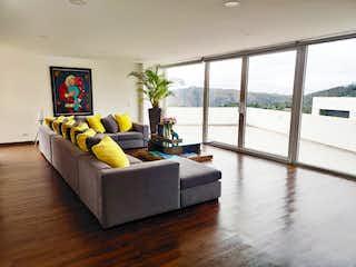 Una sala de estar llena de muebles y una gran ventana en Casa en Venta con terraza En La Calera de 400m2
