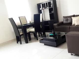 Una sala de estar llena de muebles y una televisión de pantalla plana en Casa en venta en Santa Mónica, 110mt