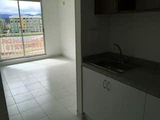 Un baño con un lavabo y una ventana en Apartamento en venta en Tocancipa de tres habitaciones