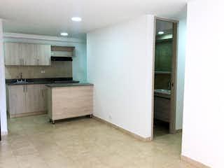 Un refrigerador congelador blanco sentado dentro de una cocina en Apartamento en venta en Ciudad del Río, 70mt con balcon