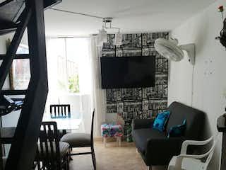 Una sala de estar llena de muebles y una chimenea en Apartamento en venta en Niquía, de 60mtrs2