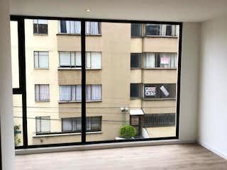Una vista de una habitación con una puerta de cristal en Entorno 106