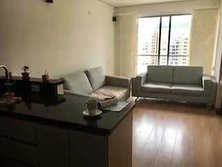 Una sala de estar llena de muebles y una televisión de pantalla plana en Apartamento en venta en Parques de Salitre, 72mt con balcon