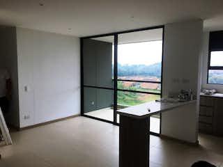 Una vista de una cocina con un gran ventanal en FOREST