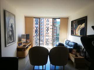 Una sala de estar llena de muebles y una televisión de pantalla plana en parques de santa catalina
