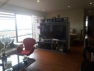 Una sala de estar llena de muebles y una televisión de pantalla plana en Panoramia Park