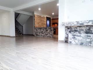 Una sala de estar llena de muebles y una chimenea en Casa en venta en Cajica, 400mt de dos niveles