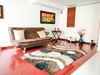 Una sala de estar llena de muebles y una televisión de pantalla plana en Conjunto Cerrado Trigales