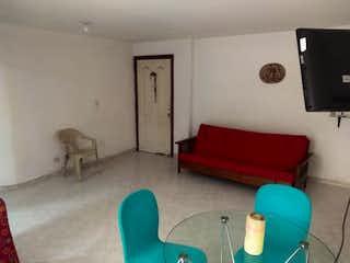 Una sala de estar llena de muebles y una chimenea en Apartamento en venta en Santa Mónica, de 97,95mtrs2