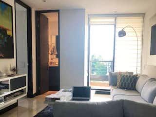Una sala de estar llena de muebles y una ventana en Edificio Omega 134 P.H