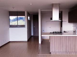 Un cuarto de baño con lavabo y un espejo en Apartamento en venta en El Porvenir de dos habitaciones