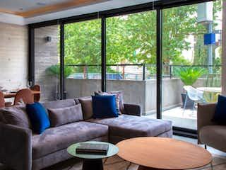 Una sala de estar llena de muebles y una ventana en Musset 326