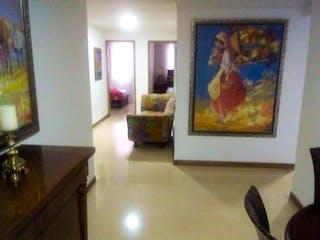 Una sala de estar con una pintura en la pared en Apartamento en venta en Las Acacias de tres alcobas