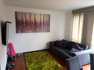 Una sala de estar llena de muebles y una ventana en Apartamento En Venta En La Felicidad de 67m2