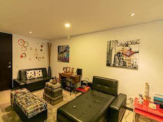 Una sala de estar llena de muebles y una televisión de pantalla plana en Apartaestudio En Venta En Bogota Chapinero