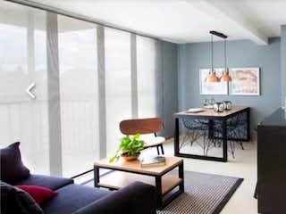 Una sala de estar llena de muebles y una televisión de pantalla plana en Apartamento en venta en Fontibón, de 57mtrs2