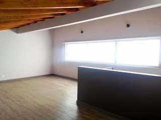 Una habitación que tiene una cama en ella en Casa en venta en El Porvenir de 178mts, dos niveles