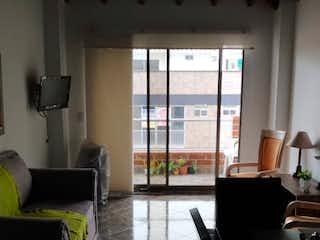 Un par de sillas negras en una habitación en  LA RIVIERA