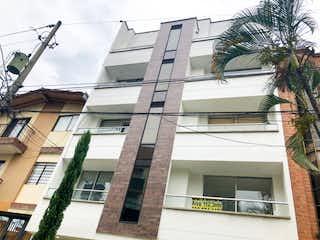Un edificio con un reloj en el costado en VENTA APARTAMENTO BELEN ROSALES  MEDELLIN