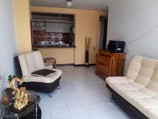 Una sala de estar llena de muebles y una televisión de pantalla plana en Apartamentos Comedal