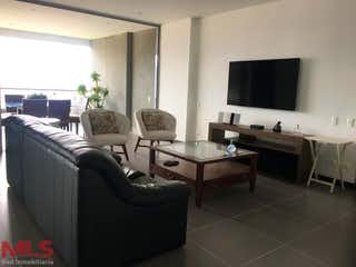 Una sala de estar llena de muebles y una televisión de pantalla plana en Atalaya de San Jorge (Loma de las Brujas)