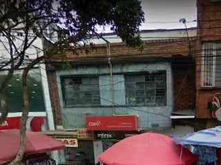 Un paraguas rojo sentado delante de un edificio en Casa en venta en Las Cruces de 287m²