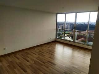 Una vista de una sala de estar desde una ventana en Apartamento En Venta En Bogota La Felicidad de 74m2