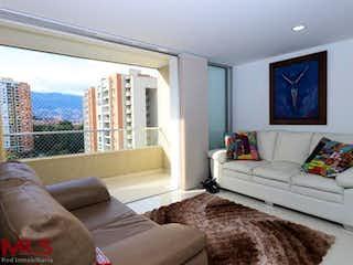 Una sala de estar llena de muebles y una gran ventana en Mirador De Los Bernal