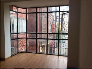 Una ventana que tiene una ventana de cristal en Apartaestudio en venta en Teusaquillo de 38m2