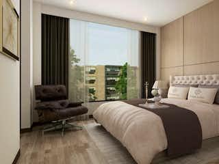 Una habitación de hotel con dos camas y un sofá en Senior Suites