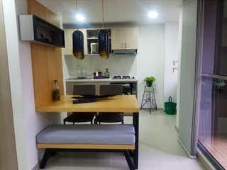 Una cocina con un fregadero y un horno de cocina en Ciudadela monteflor