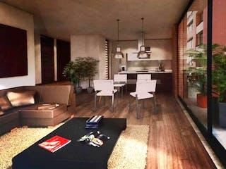 Una sala de estar llena de muebles y una mesa en Apartamento En Venta En Chicó Reservado de 90m2