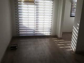 Una vista de una habitación con una puerta corredera de cristal en Conjunto Camino Real