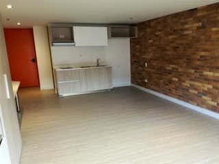 Un cuarto de baño con lavabo y ducha en Apartamento en venta en Barrio Chapinero de una habitacion