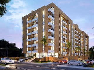 Un edificio alto con un reloj a su lado en Apartamento en venta en Casco Urbano El Carmen De Viboral de 3 alcoba
