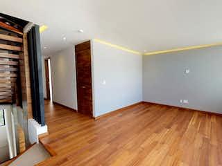 Una sala de estar con suelos de madera dura y suelos de madera en Andrés de la Concha 2