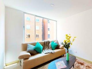 Una sala de estar llena de muebles y flores en Apartamento En Venta En Suba Salitre de 72m2