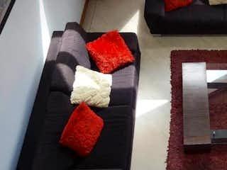 Una foto de una cama con una manta roja en Casa en venta en Casa Blanca Suba de 295mts