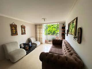Una sala de estar llena de muebles y un sofá en EDIFICIO SEBASTIANA