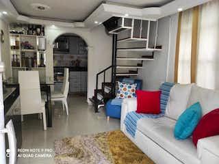Una sala de estar llena de muebles y una mesa en Conjunto Sabana Verde 2